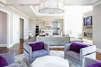 Square armchairs with purple cushions