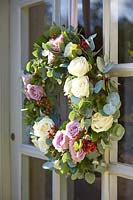 Front door with wreath of Roses and Eucalyptus foliage