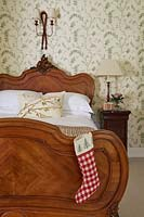 Ornate bed with christmas stocking