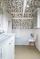 Bathroom with patterned wallpaper