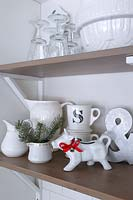 Christmas decorations on kitchen shelves