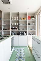 Contemporary kitchen with tiled floor