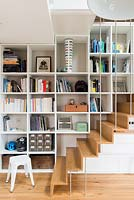 Open plan staircase and built in storage