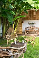Cane armchairs on lawn