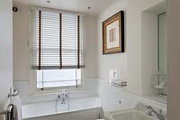 Blinds at bathroom window