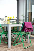 Colourful furniture on roof terrace