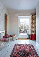 Colourful rug in hallway