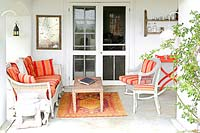 Colourful furniture on veranda