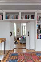 Bookshelves above doorway