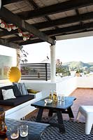 Covered seating area on roof terrace