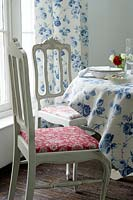 Colourful soft furnishings in dining room
