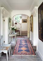 Patterned rug in hall