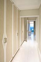 Corridor with tiled flooring