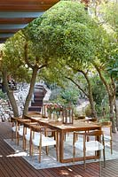 Outdoor dining area beneath trees