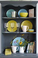 Colourful crockery on dresser