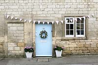 Cottage front door with floral wreath