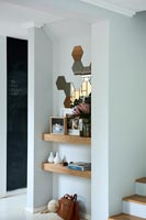 Wooden shelves in alcove