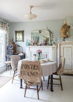 Dining room with vintage furniture and collectibles