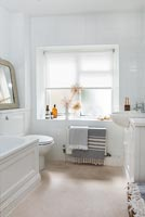 White roller blinds at bathroom window