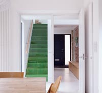 Green carpet on staircase