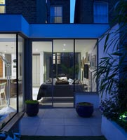 Modern open plan extension lit up at night