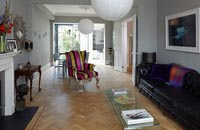 Open plan living space with parquet flooring