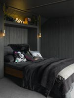 Wooden cladding around bed