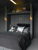 Pendant lights beside bed