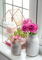 Roses and Peony flowers on windowsill