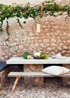 Dining area under rustic pergola