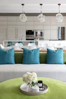 Turquoise cushions on sofa