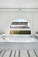 Marble bathtub with shower