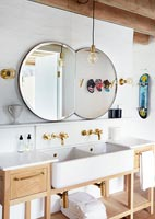 Bathroom sinks with wooden cabinets