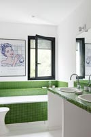 Bath with green tiles