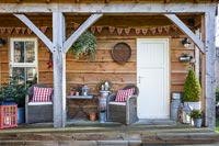 Wooden summerhouse with christmas decorations