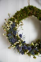 Wreath of moss and Sea holly flowers