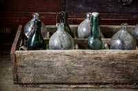 Detail of vintage bottles in a crate