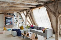 Open plan living space with exposed beams