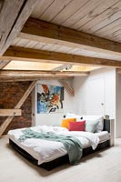 Bedroom with exposed beams