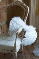 Detail of chair with angel wings