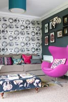 Modern living room with patterned wallpaper