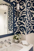 Detail of blue and white wallpaper in the bathroom