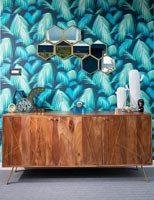 Vintage wooden sideboard against feature wall