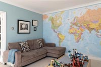 Playroom with world map wallpaper