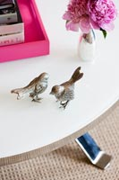 Detail of bird ornaments on table