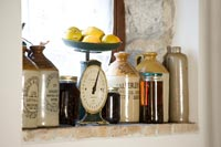 Detail of windowsill with vintage bottles