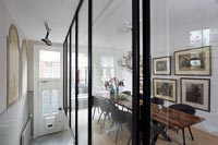 Contemporary dining room viewed through glass wall