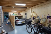 Garage with car and bicycles