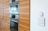 Modern kitchen cabinets with integrated oven