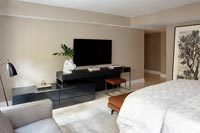 Modern bedroom with large wall mounted television